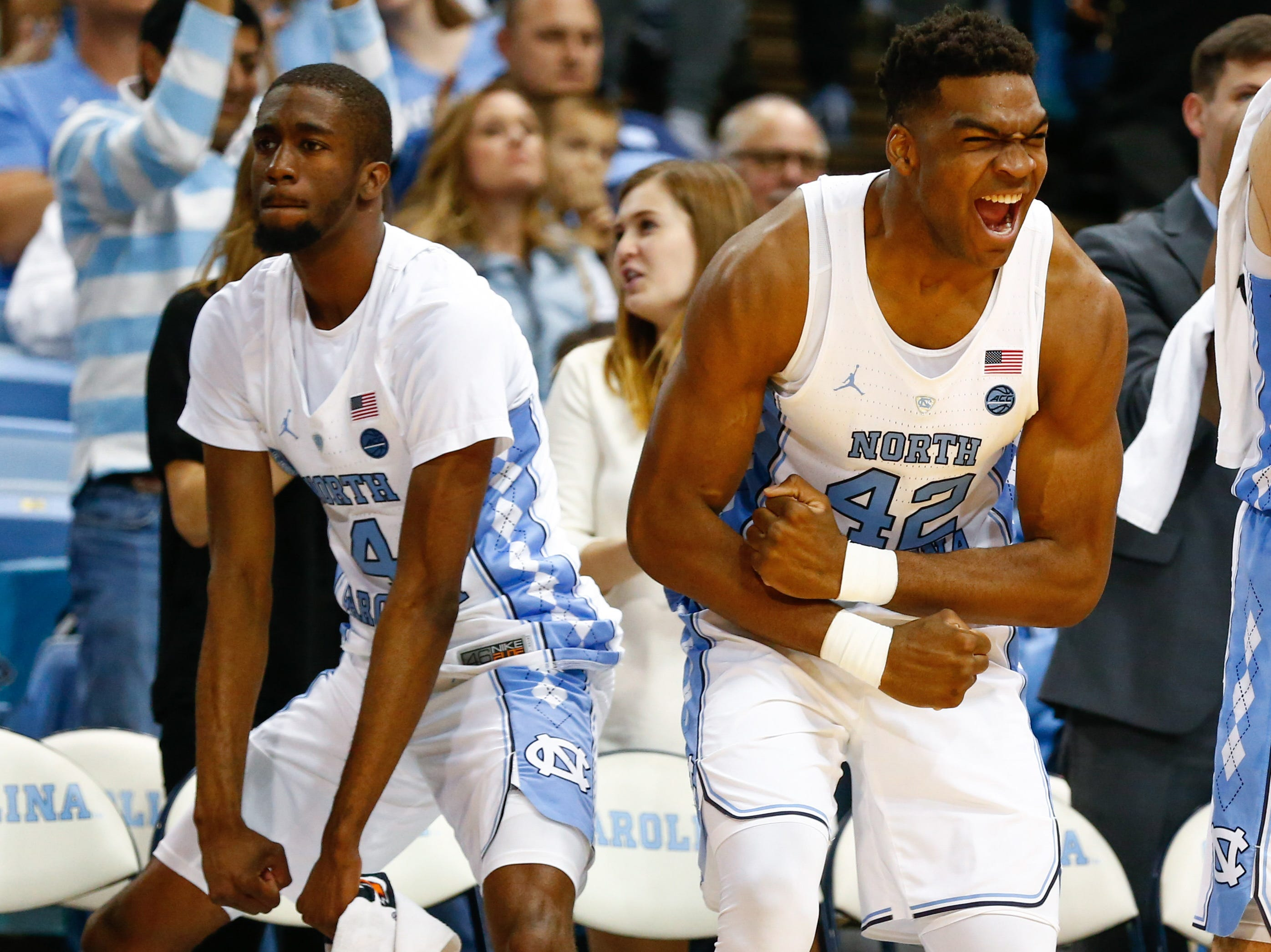 Dec 6, 2017; Chapel Hill, NC, USA; North Carolina Tar Heels forward Brandon Huffman (42) and guard Brandon Robinson (4) react to a basket in the second half against the Western Carolina Catamounts at Dean E. Smith Center. Mandatory Credit: Jeremy Brevard-USA TODAY Sports