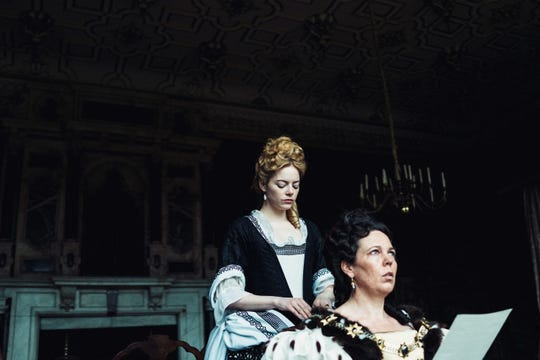 "Emma Stone and Olivia Colman in the film ""The Favourite."""