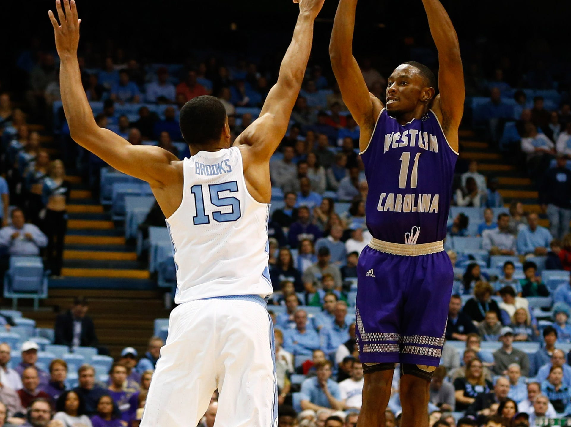 Dec 6, 2017; Chapel Hill, NC, USA; Western Carolina Catamounts guard Haboubacar Mutombo (11) shoots a three pointer against North Carolina Tar Heels forward Garrison Brooks (15) in the first half at Dean E. Smith Center. Mandatory Credit: Jeremy Brevard-USA TODAY Sports