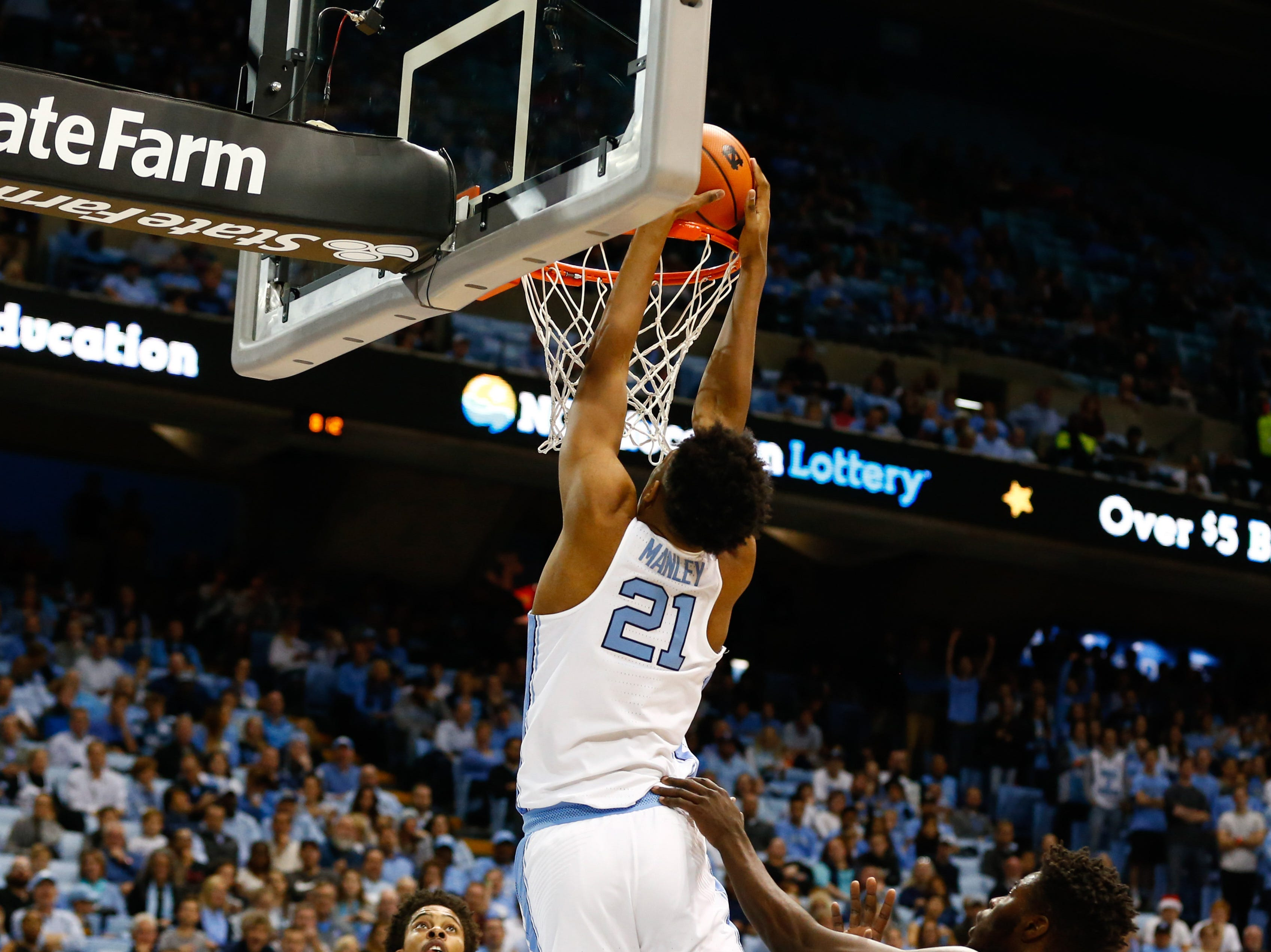 Dec 6, 2017; Chapel Hill, NC, USA; North Carolina Tar Heels forward Sterling Manley (21) dunks the ball in the second half against the Western Carolina Catamounts at Dean E. Smith Center. Mandatory Credit: Jeremy Brevard-USA TODAY Sports