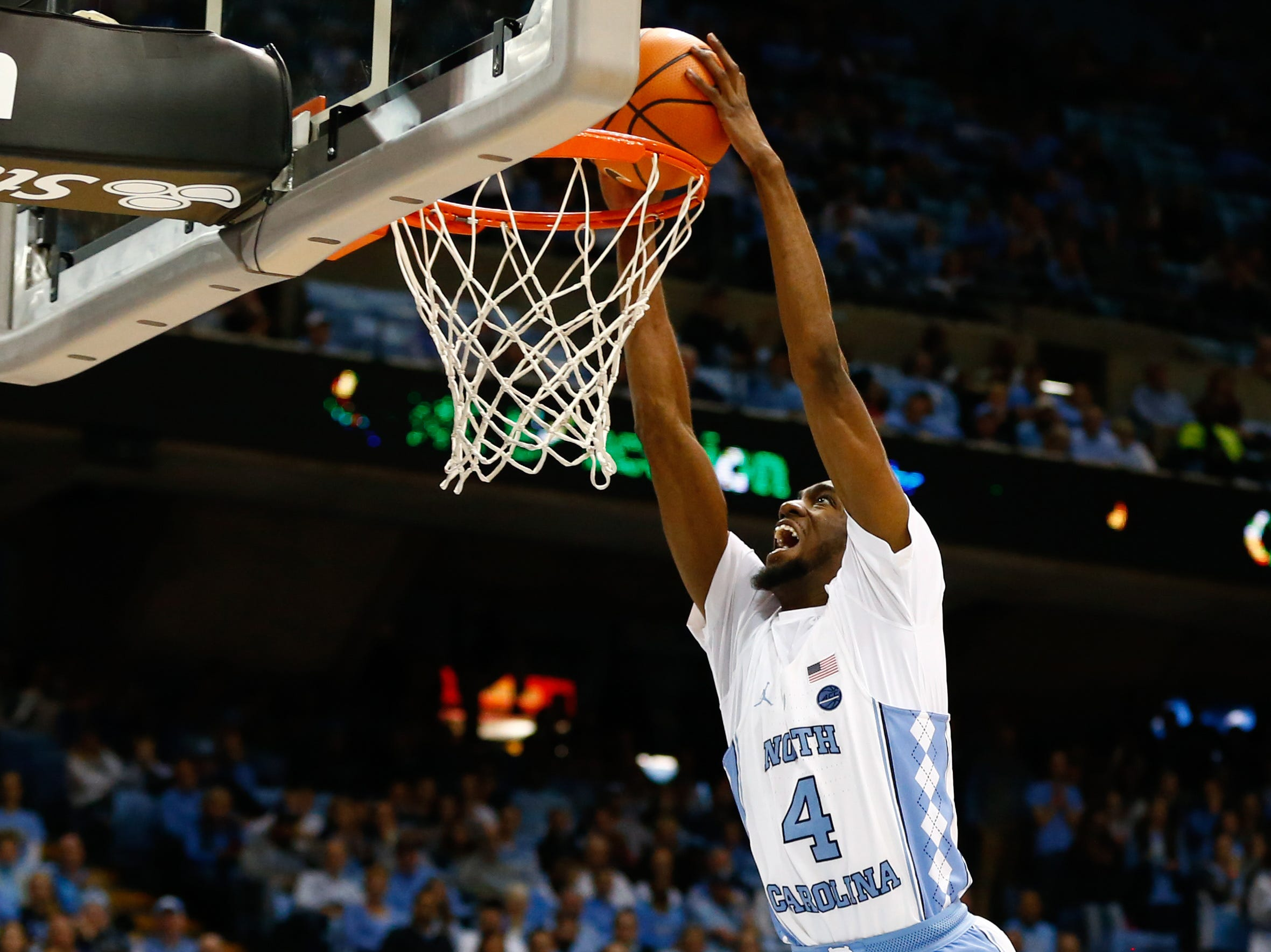 Dec 6, 2017; Chapel Hill, NC, USA; North Carolina Tar Heels guard Brandon Robinson (4) dunks the ball in the second half against the Western Carolina Catamounts at Dean E. Smith Center. Mandatory Credit: Jeremy Brevard-USA TODAY Sports