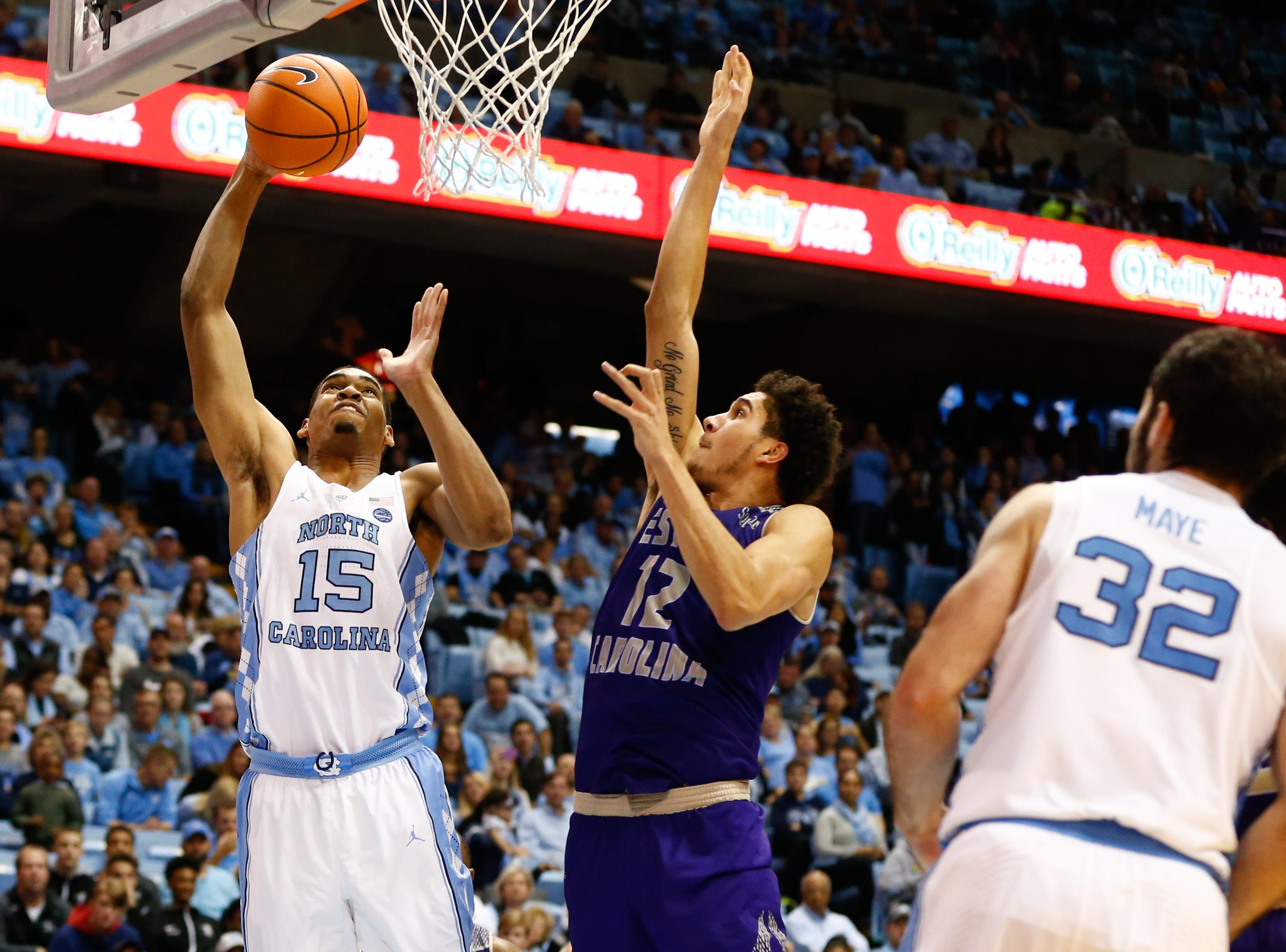 Dec 6, 2017; Chapel Hill, NC, USA; North Carolina Tar Heels forward Garrison Brooks (15) shoots the ball against Western Carolina Catamounts forward Marc Gosselin (12) in the second half at Dean E. Smith Center. Mandatory Credit: Jeremy Brevard-USA TODAY Sports