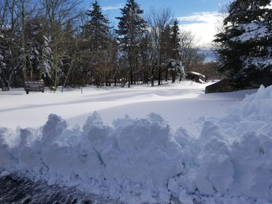 The attractions at the Grandfather Mountain Stewardship Foundation, including the Mile High Swinging Bridge and hiking trails, are closed after the park received about 18 inches of snow over the weekend.