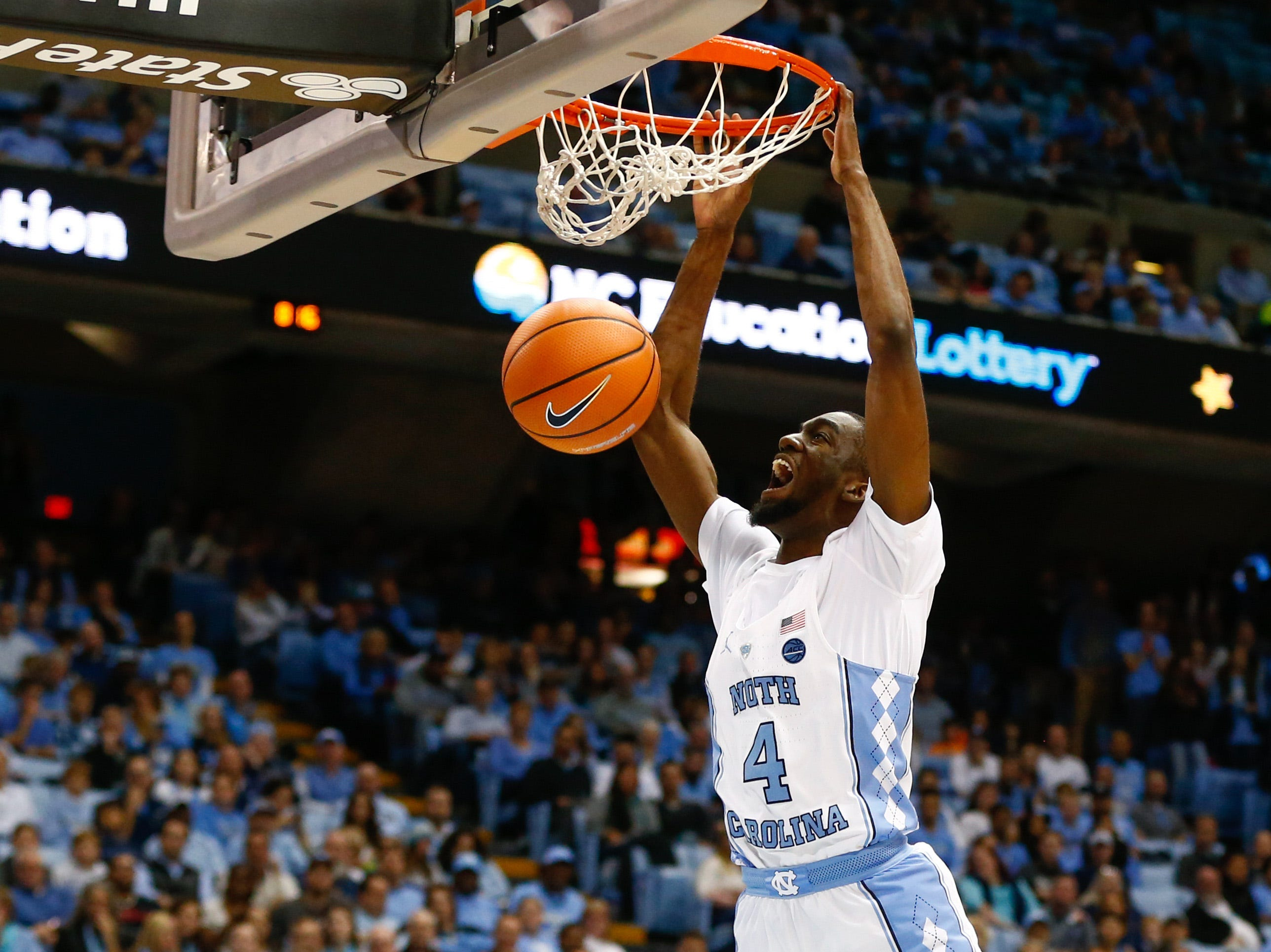 Dec 6, 2017; Chapel Hill, NC, USA; North Carolina Tar Heels guard Brandon Robinson (4) screams as he dunks the ball in the second half against the Western Carolina Catamounts at Dean E. Smith Center. Mandatory Credit: Jeremy Brevard-USA TODAY Sports