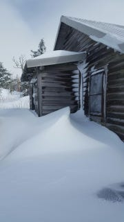 A ranger's residence at Mount Mitchell State Park is covered in snowdrifts after winter storm Diego dropped 34 inches in the park.