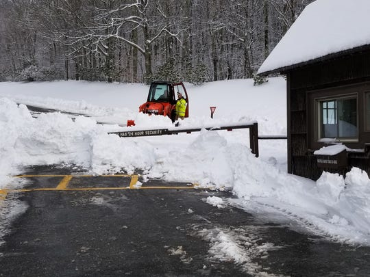 Crews worked to clear the roads at Grandfather Mountain, which received at least 18 inches of snow in December, contributing to a year of record precipitation.