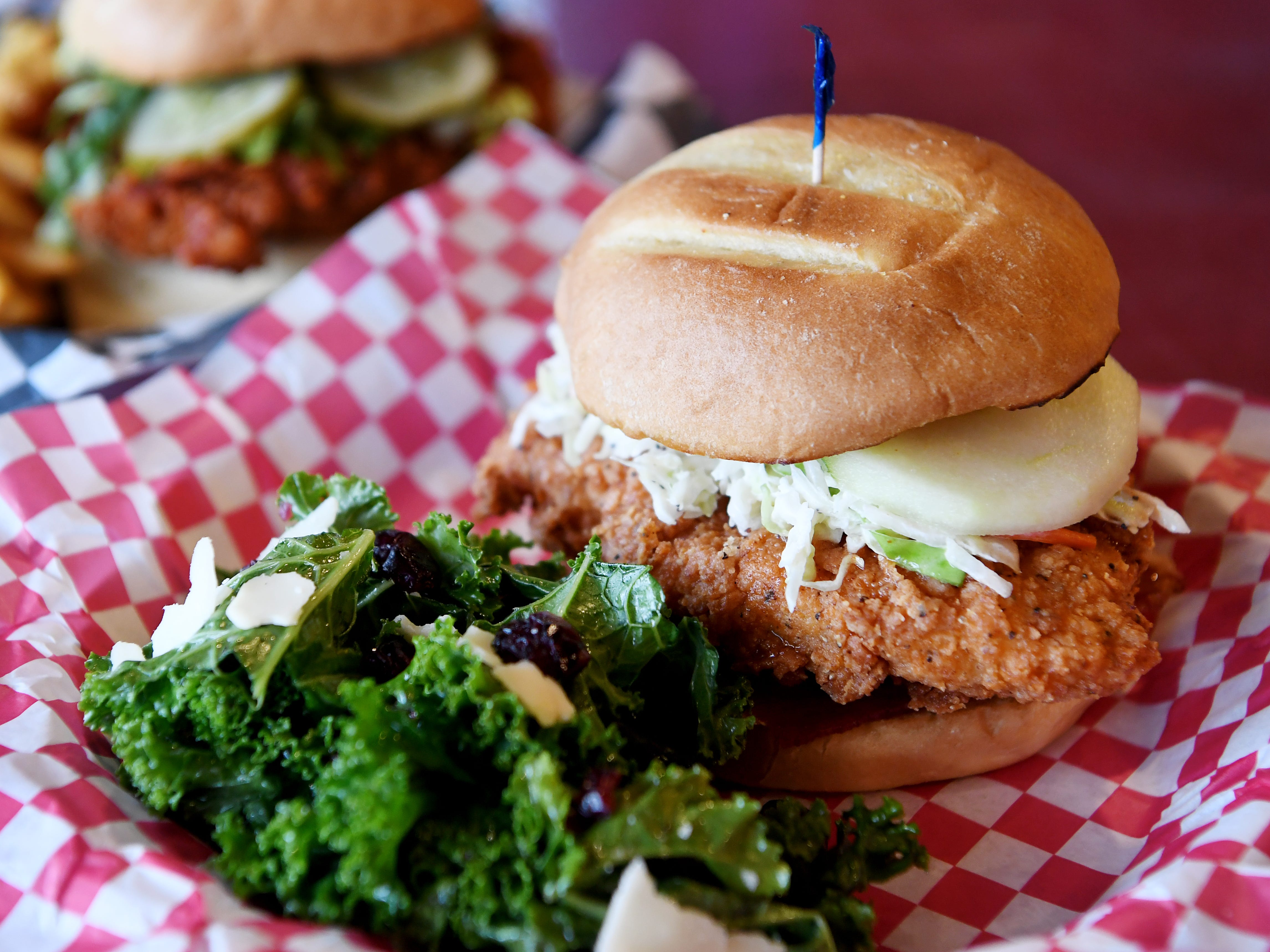 The Asheville chicken sandwich with a kale salad at Henrietta's Poultry Shoppe in Asheville Dec. 7, 2018.