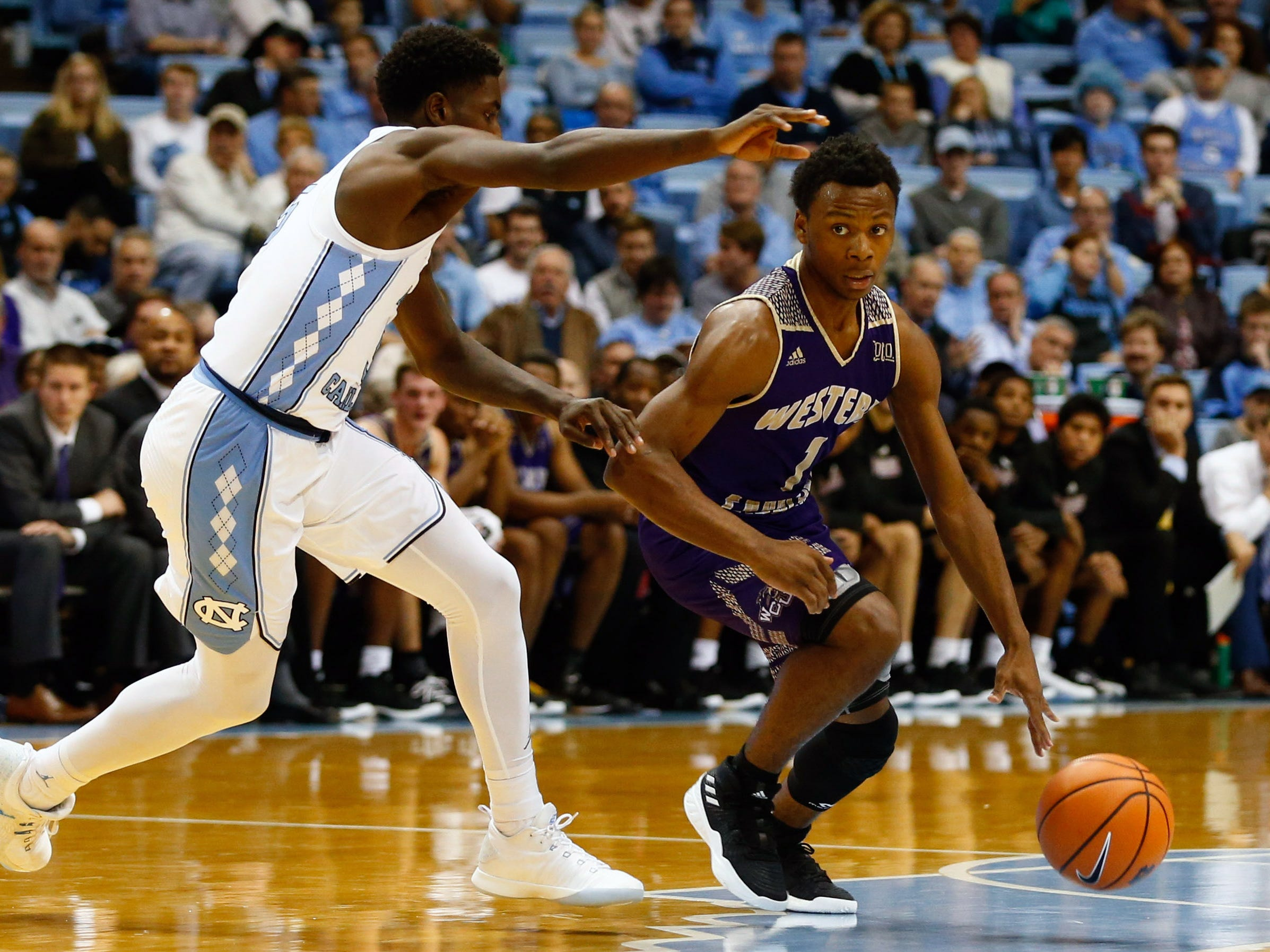 Dec 6, 2017; Chapel Hill, NC, USA; Western Carolina Catamounts guard Desmond Johnson (1) drives the ball against North Carolina Tar Heels guard Jalek Felton (5) in the first half at Dean E. Smith Center. Mandatory Credit: Jeremy Brevard-USA TODAY Sports