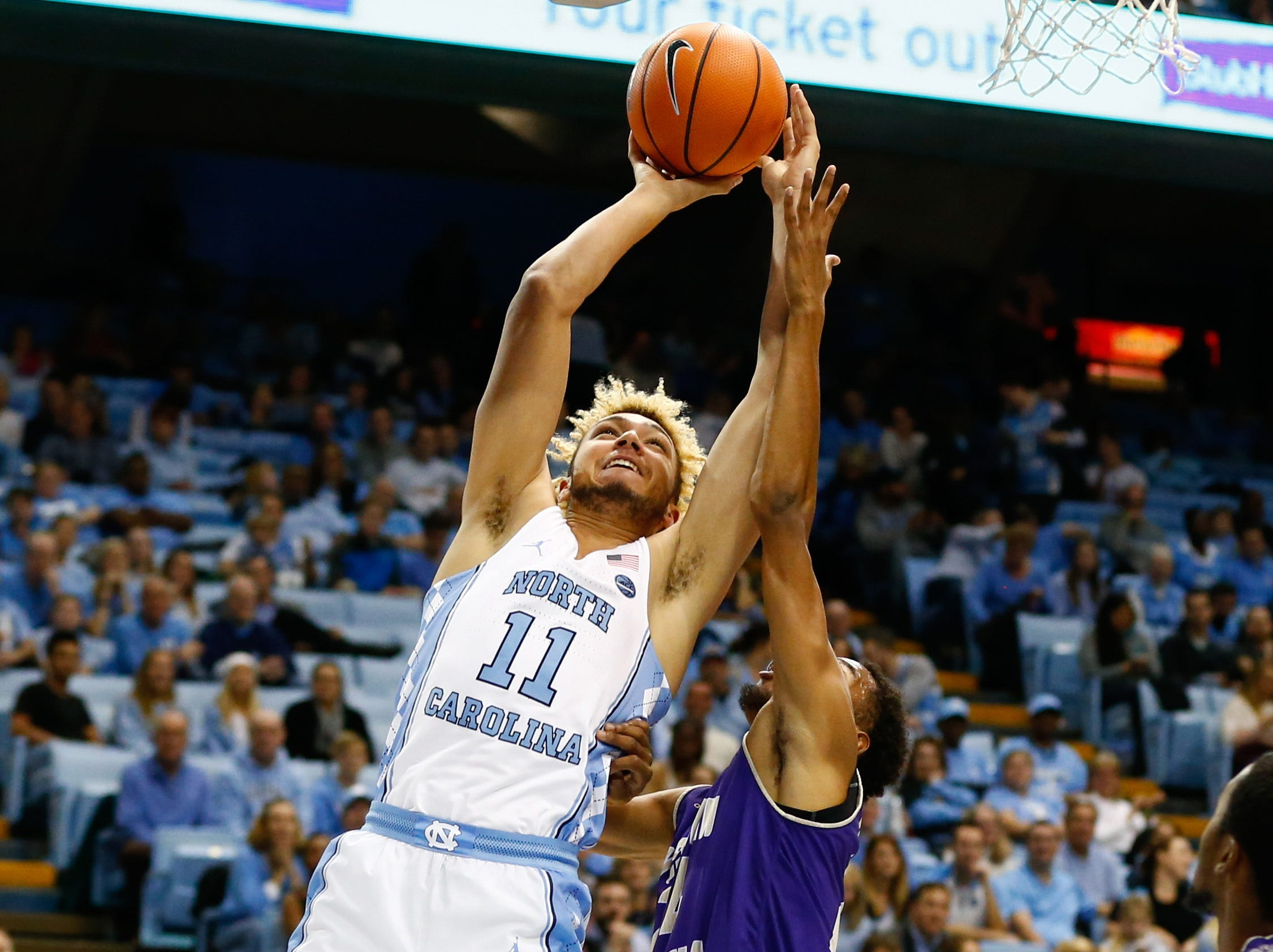 Dec 6, 2017; Chapel Hill, NC, USA; North Carolina Tar Heels forward Shea Rush (11) shoots the ball in the second half against the Western Carolina Catamounts at Dean E. Smith Center. Mandatory Credit: Jeremy Brevard-USA TODAY Sports