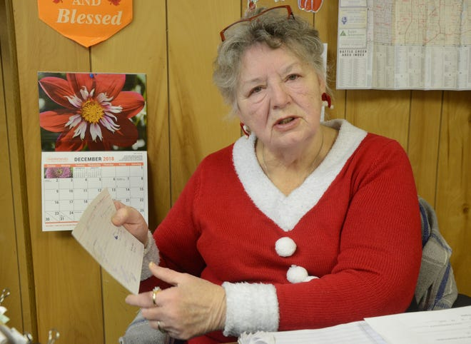 Darlene Williams keeps her records or note cards as she matches donors with recipients.