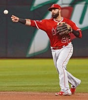 The Seattle Mariners claimed Kaleb Cowart from the Angels and may attempt to use him as both an infielder and a pitcher.