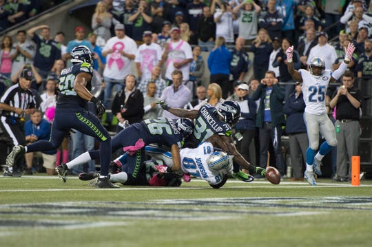 Seahawks safety Kam Chancellor forced a fumble by Lions wide receiver Calvin Johnson during a Monday Night Football game in October 2015.
