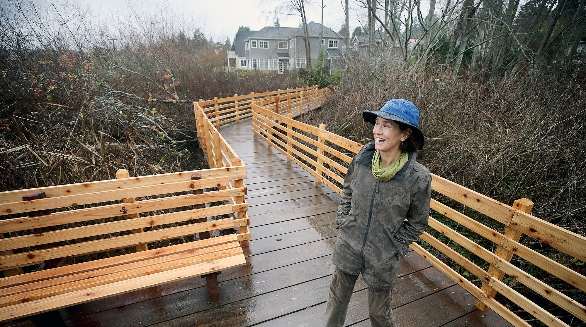 Barb Trafton of the Bainbridge Island Parks Foundation is on one of the new boardwalks at Hawley Cove Park on Bainbridge Island on a wet and windy Tuesday, December, 11, 2018.