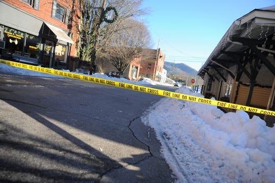 A section of Sutton Avenue in downtown Black Mountain was closed off by firefighters who were responding to reports of a partially collapsed roof on Dec. 11.