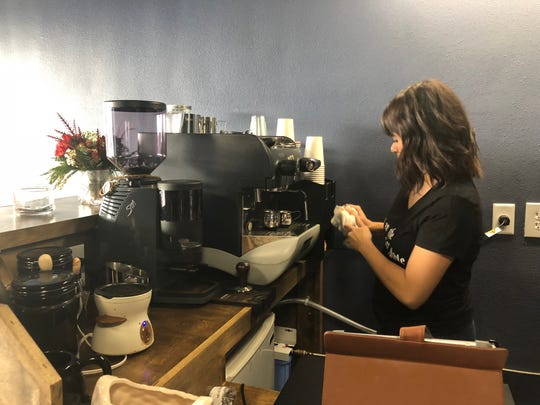 "Susan Almaguer cleans the coffee bar at the new The ""Coffee Muggle"" location on Morgan Avenue."