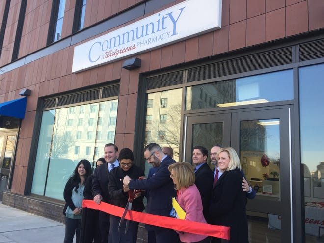 Rutgers-Camden Chancellor Phoebe Haddon and John Colaizzi, Regional Director of Specialty Pharmacy Operations for Walgreens, cut the ribbon on the Community Pharmacy on Federal Street in Camden.
