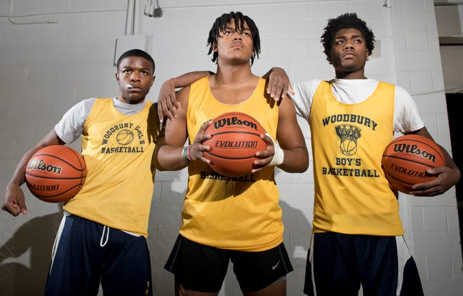 Woodbury High School boys basketball senior players (from left), Tommy Carter, Isaiah Bailey, and Jayshawn Harvey hope to lead their team to another state championship.