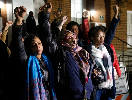 "Local activists raise their fists outside Charlottesville General District Court after a guilty verdict was reached in the trial of James Alex Fields Jr., in Charlottesville, Va., Friday, Dec. 7, 2018. Fields was convicted of first degree murder in the death of Heather Heyer as well as nine other counts during a ""Unite the Right"" rally in Charlottesville."
