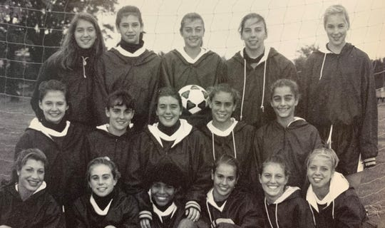 The St. Ursula soccer team won a state championship title the same day the volleyball team did, Nov. 13, 1993. They are, from left: front, Maria Peracchio, Stephanie Arling, Regina Edwards, Heather Mitts, Katie Veith and Jill Baker; middle, Peggy Scheimann, Maria Jimenez, Julie McDonald, Adrian Hogel and Annette Gruber; and back, Alli Whitaker, Katie Rouse, Amanda Gruber, Danielle Beziat and Cathy Green.
