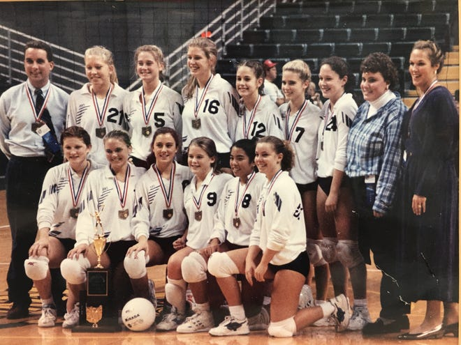 The St. Ursula Academy volleyball team won the state championship Nov. 13, 1993, the same day the soccer team won a state title. They are, from left: Back, AD and assistant coach Doug Tucker, Dena Davis, Kathy Kirby, Amanda Evers, Sarah Korte, Beth Osterday, Liz Bower, manager Ann Cassinelli and varsity coach Julie Thoman Perry; front, Beth Junker, Jenny Esselman, Heather Hagedorn, Katie Reilly, Aimee Cabrera and Anna Wittrock.