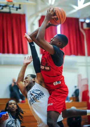 Bishop Ahr's Kobe Walker drives to the basket against Immaculata during a scrimmage on Saturday, Dec. 8, 2018 in Edison.
