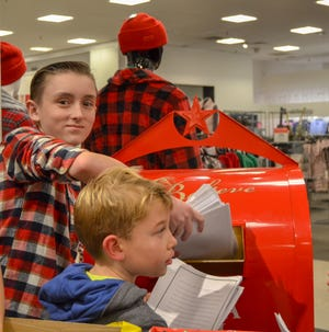 A ninth-grader at Old Bridge High School, AJ Silvestri, collected 175,987 letters for Make-A-Wish through the annual Macy's BELIEVE campaign. Silvestri depositing letters in the mailbox at Brunswick Square Macys.