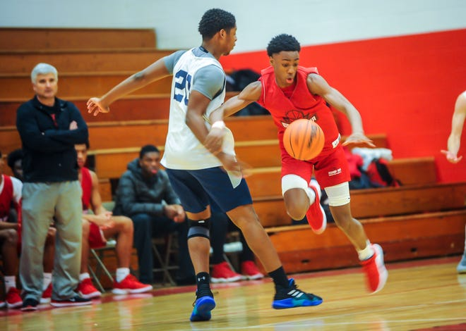 Bishop Ahr's Quadry Adams (right) looks to get around Immaculata's Jordan Myers during a scrimmage on Saturday, Dec. 8, 2018 in Edison.