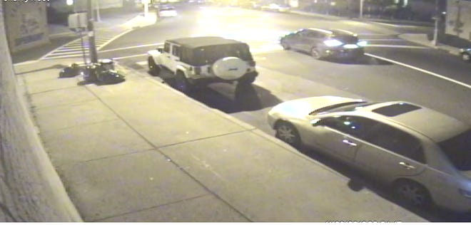 Surveillance video footage of a black Nissan Murano allegedly involved in a fatal hit and run crash in Elizabeth on Thanksgiving night.