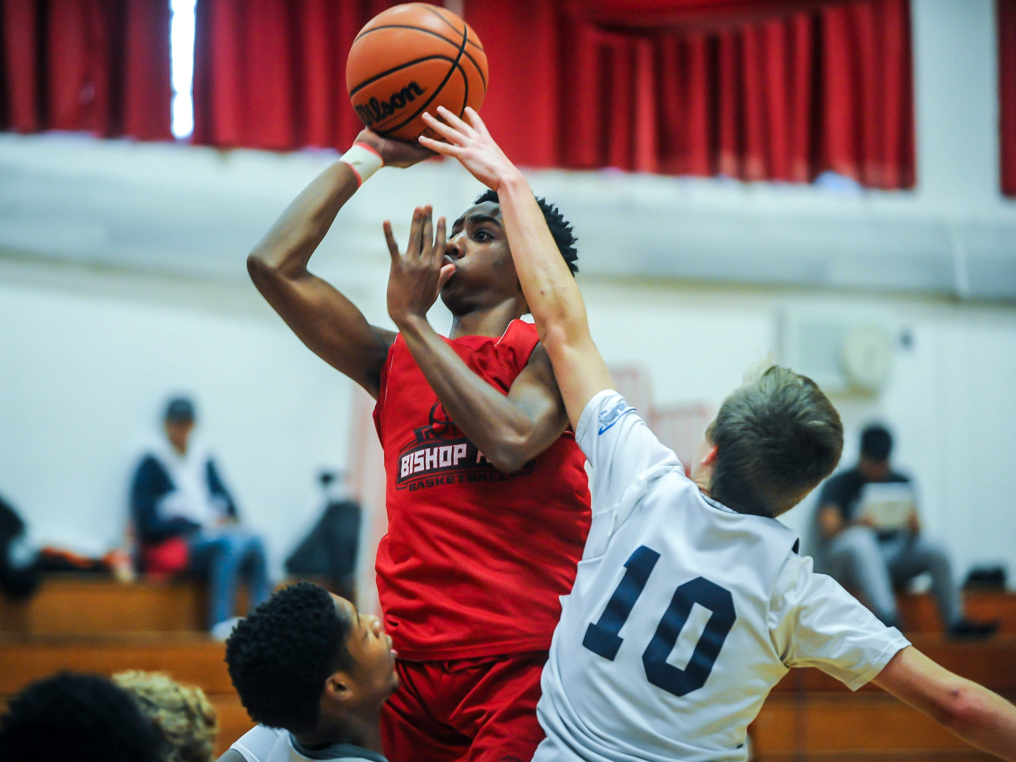 Bishop Ahr's Quadry Adams soars to the basket against Immaculata's Dan Johnson during a scrimmage on Saturday, Dec. 8, 2018 in Edison.