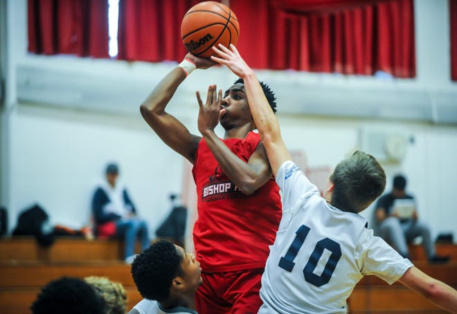 St. Thomas Aquinas' Quadry Adams soars to the basket against Immaculata's Dan Johnson during a scrimmage on Saturday, Dec. 8, 2018 in Edison.