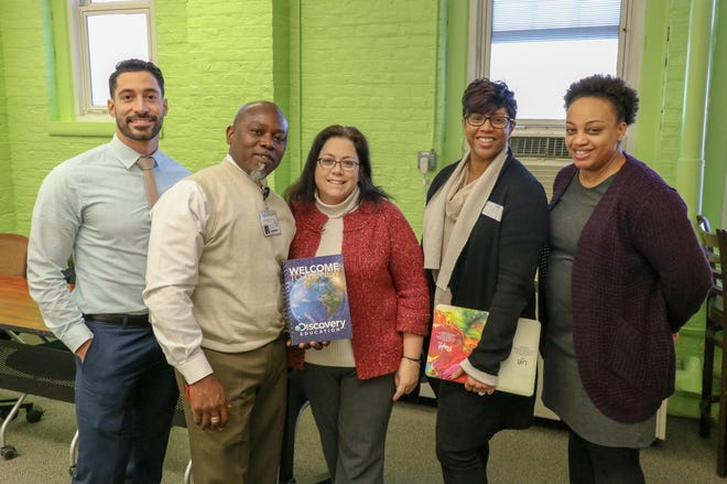 From left to right: Ricardo Garcia, Regional Partnerships Manager at Discovery Communications, Kwame Asante, Principal at Hubbard Middle School, Jean Gordon, Director of Brands for Plainfield Public Schools, Jacqueline Smalls, Educational Consultant at Discovery Education and Natasha Cox, Assistant Principal at Hubbard Middle School with the new Discovery Education Techbooks.