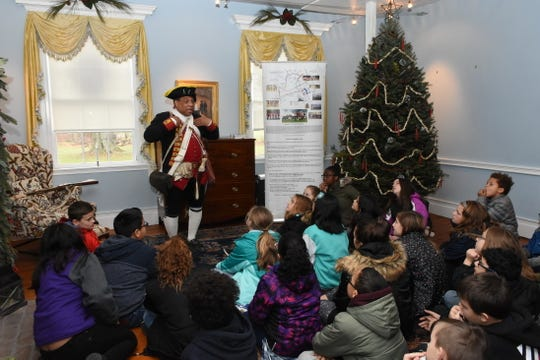 Revolutionary War hero Ned Hector, portrayed by re-enactor Noah Lewis speaks to 5th grade students from Manville's Alexander Batcho Intermediate School during School Group Tour Day at Bedminster's historic Jacobus Vanderveer House & Museum.