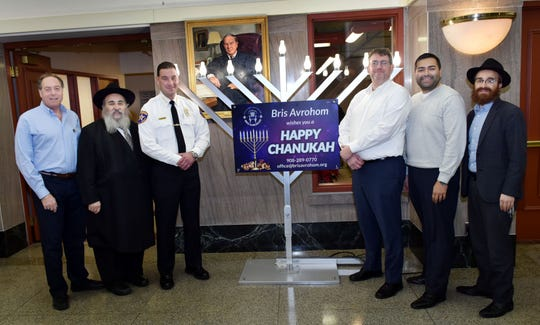 Union County Freeholder Chairman Sergio Granados and Freeholder Bruce H. Bergen, Union County Sheriff Peter Corvelli and Union County Manager Ed Oatman joined Rabbi Mordechai Kanelsky and Rabbi Avremy Kanelsky from Bris Avrohom in Hillside to light the menorah celebrating Hanukkah at the Union County Courthouse in Elizabeth.