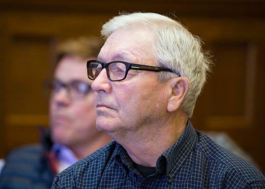 Bill Carter listens to DetectiveReedKiouswith the Marion County Sheriff's Officetestify Tuesday, Dec. 11, 2018 at the Marion County Courthouse in a hearing on whether a $10 million wrongful death judgment against Jason Carter should be overturned.