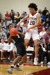 Ankeny's JaRon Crews and Ankeny Centennial's Kamron Francis fight for the ball in a Dec. 7 game. After two seasons with the Hawks, Crews has transferred to Ankeny Centennial.