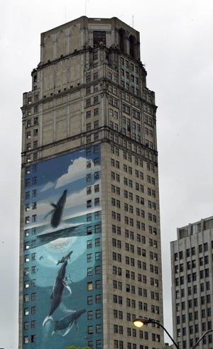 The 34-story Broderick Tower, built in the late 1920's, has been graced by a giant whale mural painted by Michigan born artist Robert Wyland in 1997. KATHLEEN GALLIGAN/Detroit Free Press