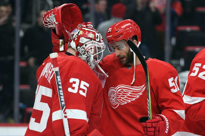 Detroit Red Wings center Frans Nielsen and goaltender Jimmy Howard celebrate the 3-1 win against the Los Angeles Kings at Little Caesars Arena, Dec. 10, 2018.