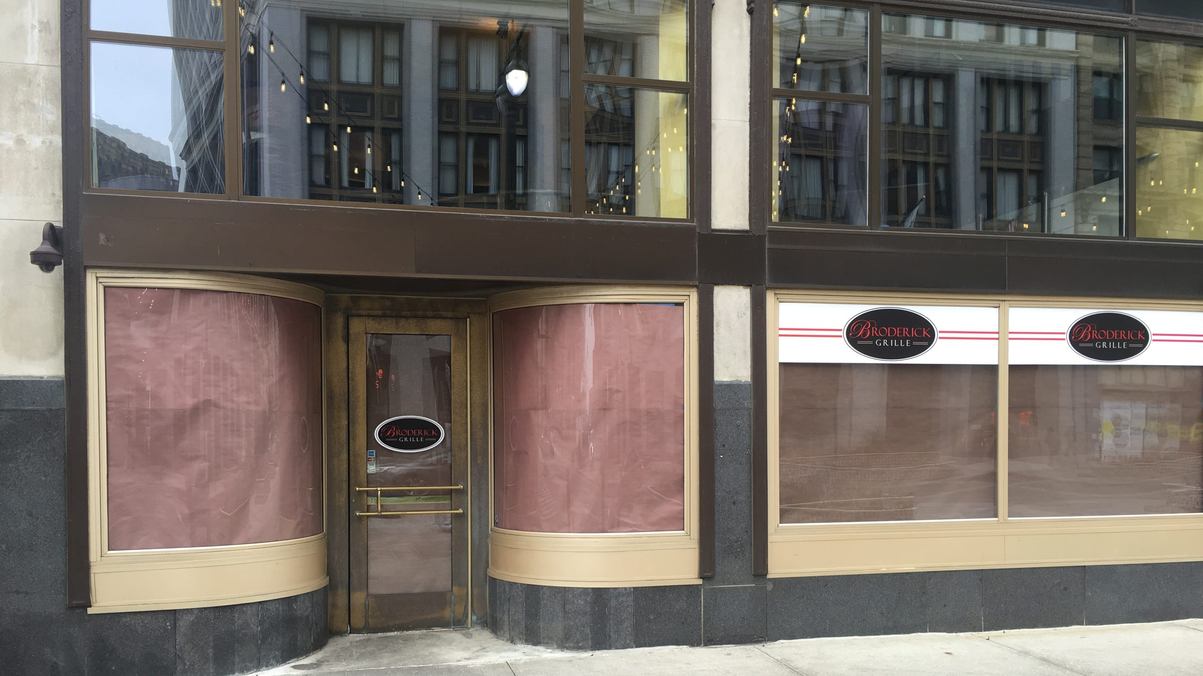 Paper covers the windows at the Broderick Grille located on the ground floor of the Broderick Tower.