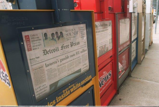Newspaper racks on display.