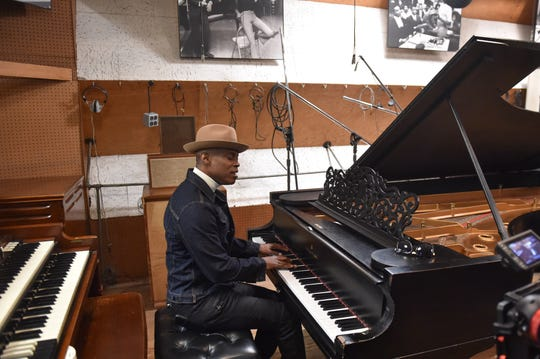 Motown recording artist Kem plays the Steinway piano in Studio A.