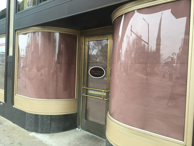 Paper covers the doors and windows of the Broderick Grille, which is on the ground floor of the Broderick Tower.