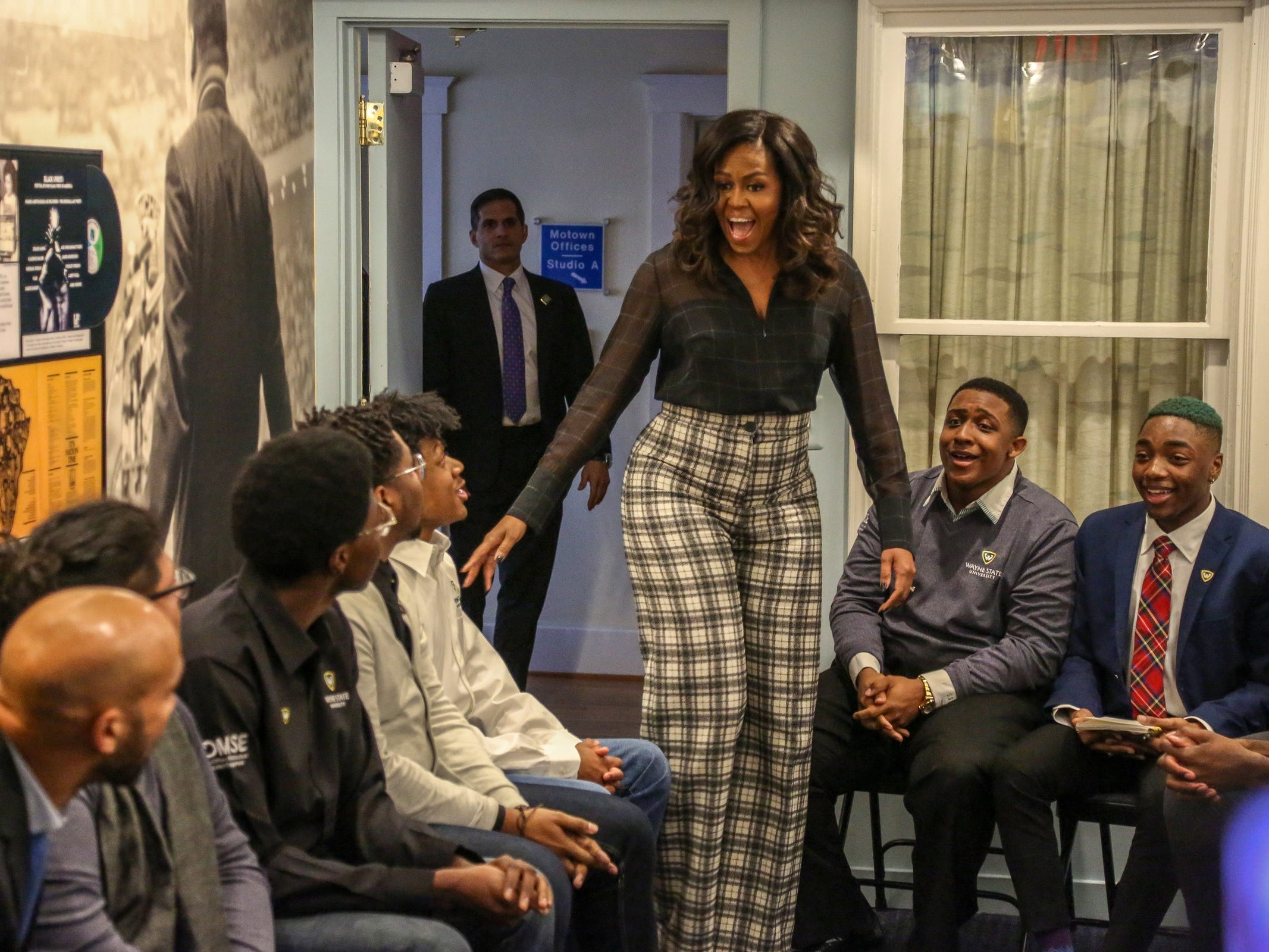 Former First Lady Michelle Obama, surprises a group of young African-American men from Wayne State University who were speaking with her brother Craig Robinson and Actor Keegan-Michael Key at Motown Museum in Detroit on Tuesday, Dec. 11, 2018.