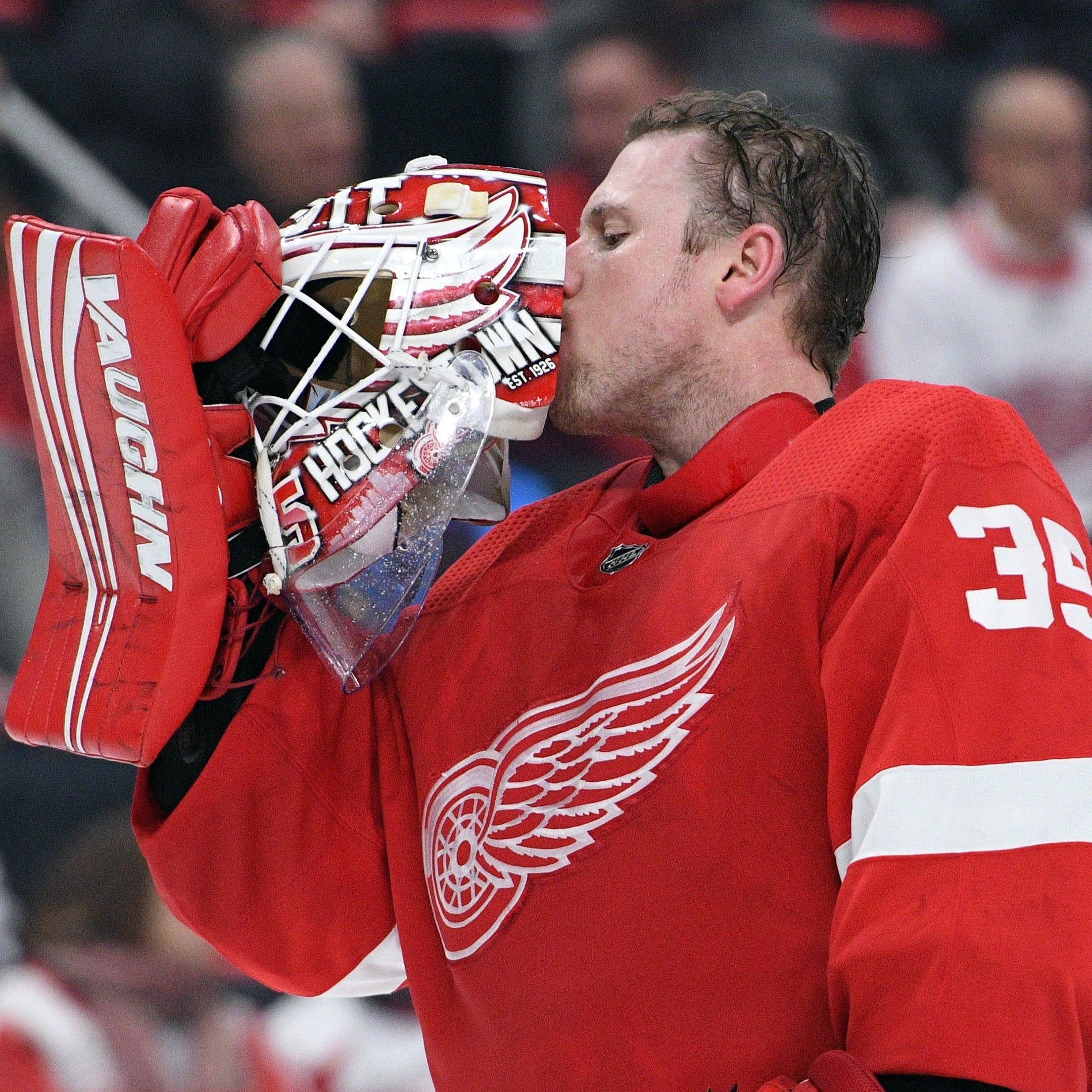 Detroit Red Wings goaltender Jimmy Howard kisses...