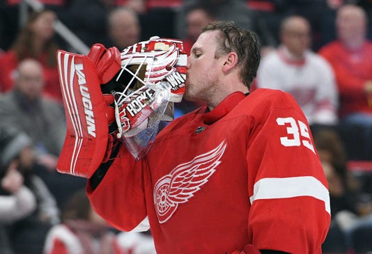 Jimmy Howard helmet kiss