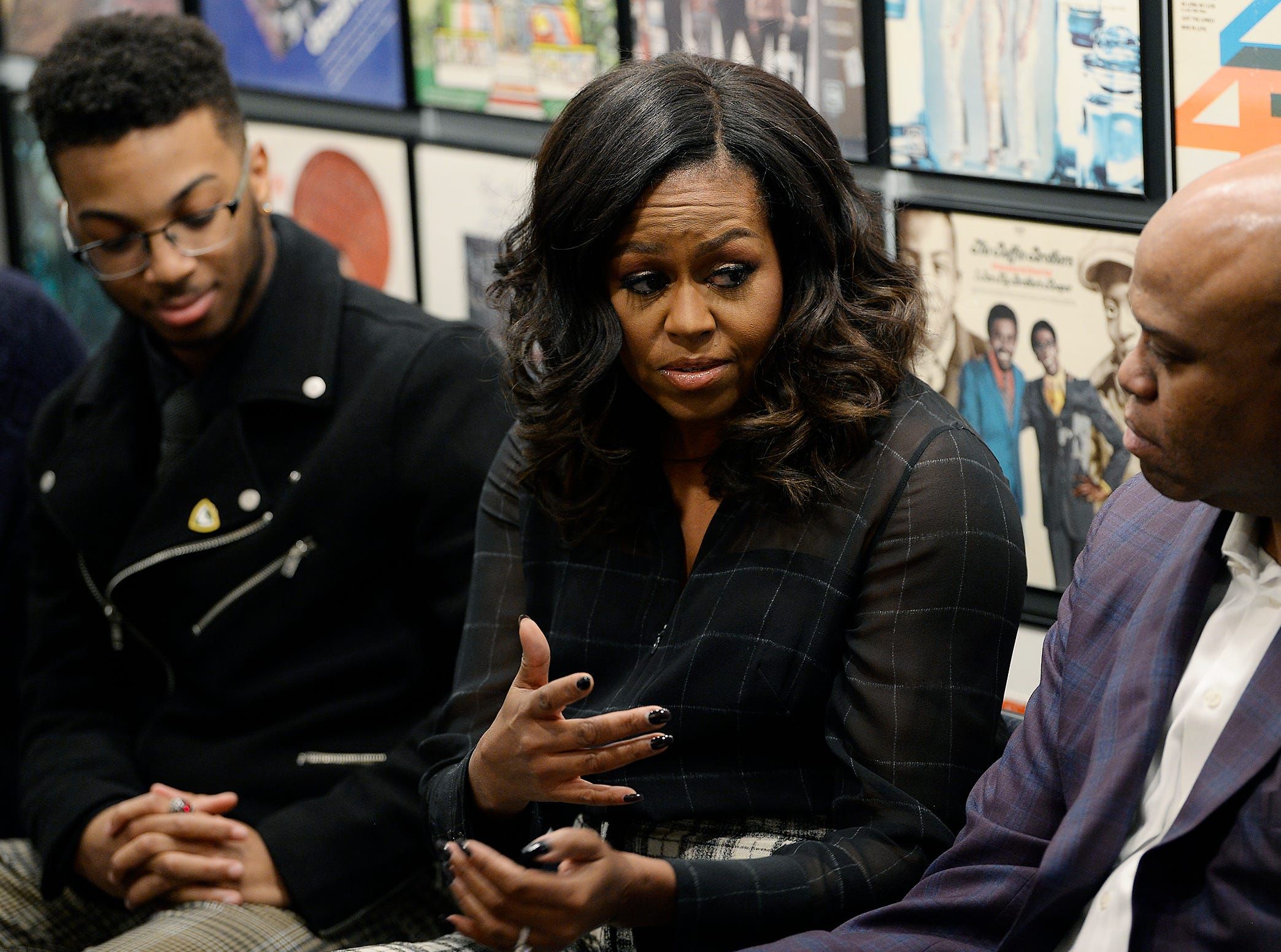 Michelle Obama participates in a group discussion with students from Wayne St. University.