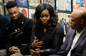 Michelle Obama participates in a group discussion with students from WSU during a visit at the Motown Museum on December 11, 2018.