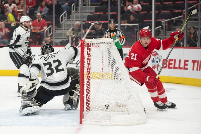 Detroit defenseman Dennis Cholowski sends the puck past Los Angeles goaltender Jonathan Quick for a goal in the first period during the Red Wings 3-1 win over the Kings at Little Caesars Arena, in Detroit, December 10, 2018.