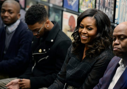 Michelle Obama participates in a group discussion at the Motown Museum in Detroit.