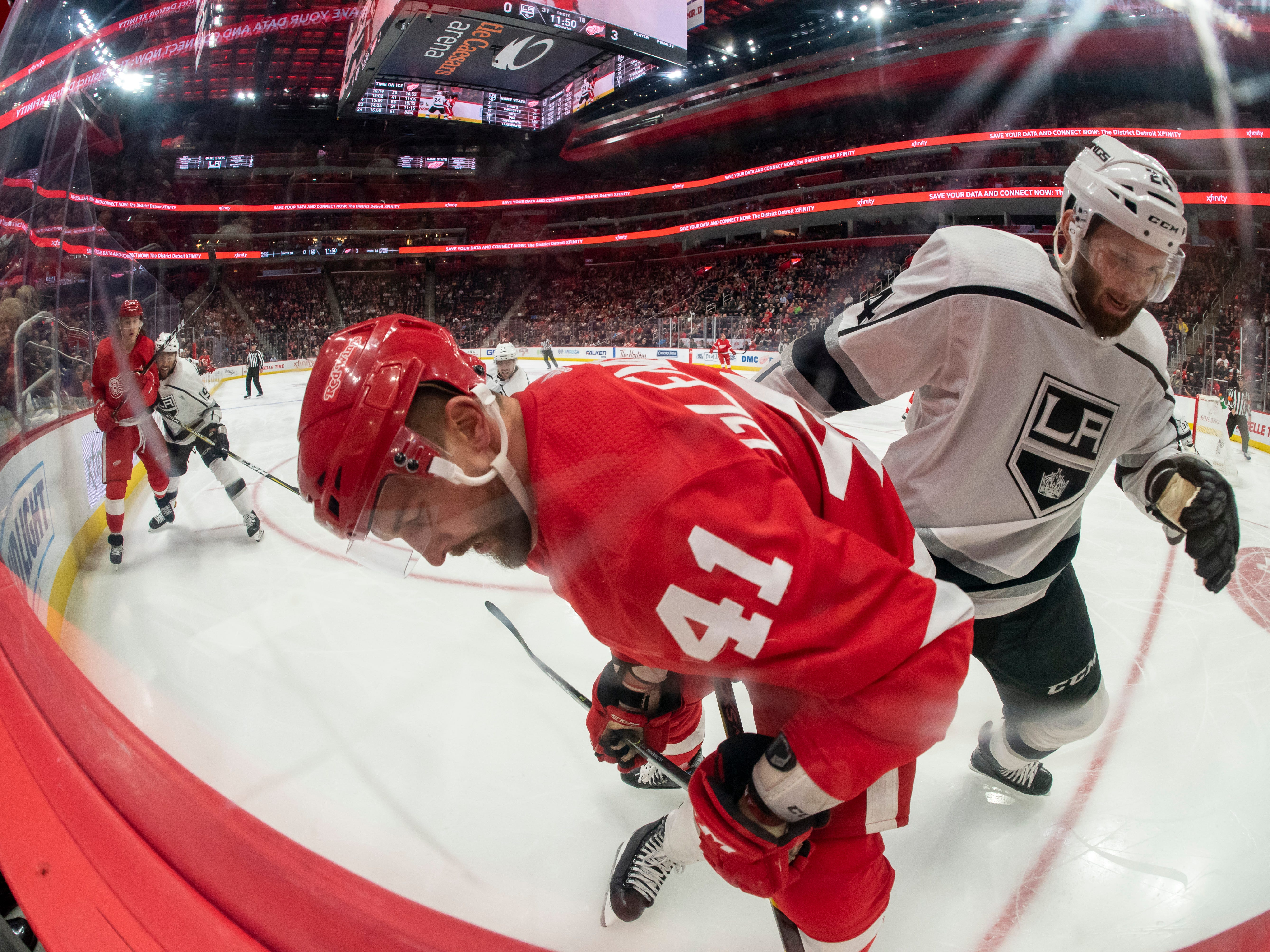 Detroit center Luke Glendening and Los Angeles defenseman Derek Forbort battle for the puck along the boards in the third period.