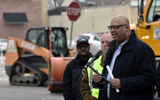 Detroit DPW Director Ron Brundidge stands with employees and sub-contractors as he announces new snow-removal procedures on Detroit's city streets this winter.